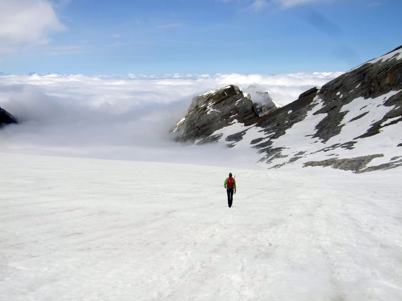 Dscf5493_jeremy_walking_down_glacier_over_clouds