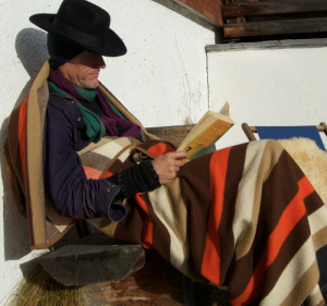 Taking a break and reading in the Swiss winter sun